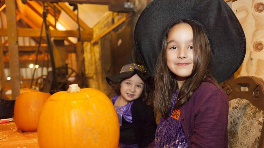kent life girls dressed as witches with pumpkins