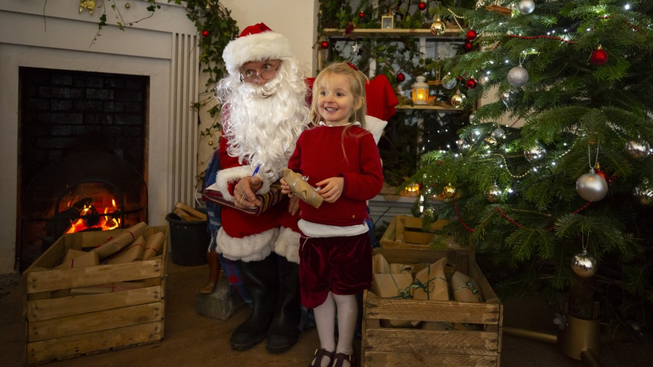 Girl visiting Santa's grotto at Hestercombe