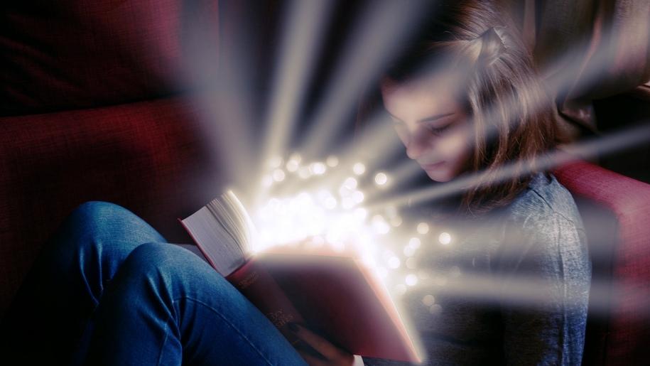 Girl reading a magical storybook at Hestercombe