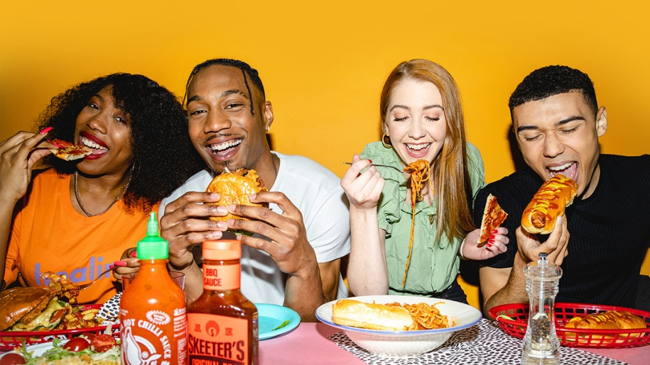 a picture of people eating takeaway food
