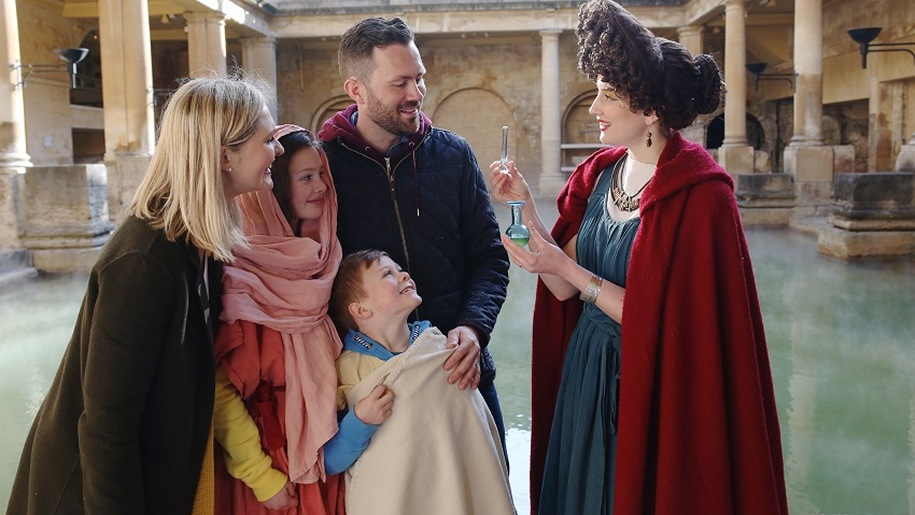 Family dressing up with characters at Roman Baths