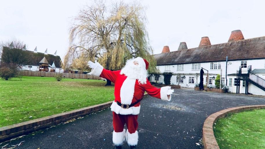 Santa standing outside Hop Farm