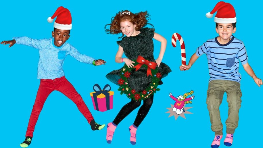 Children jumping with Christmas hats and decs
