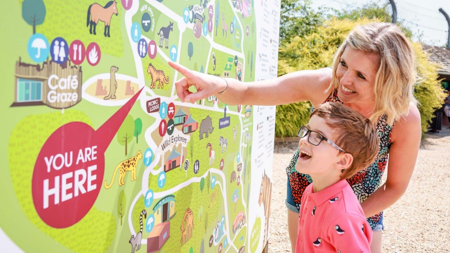 mum and boy looking at map of Marwell Zoo