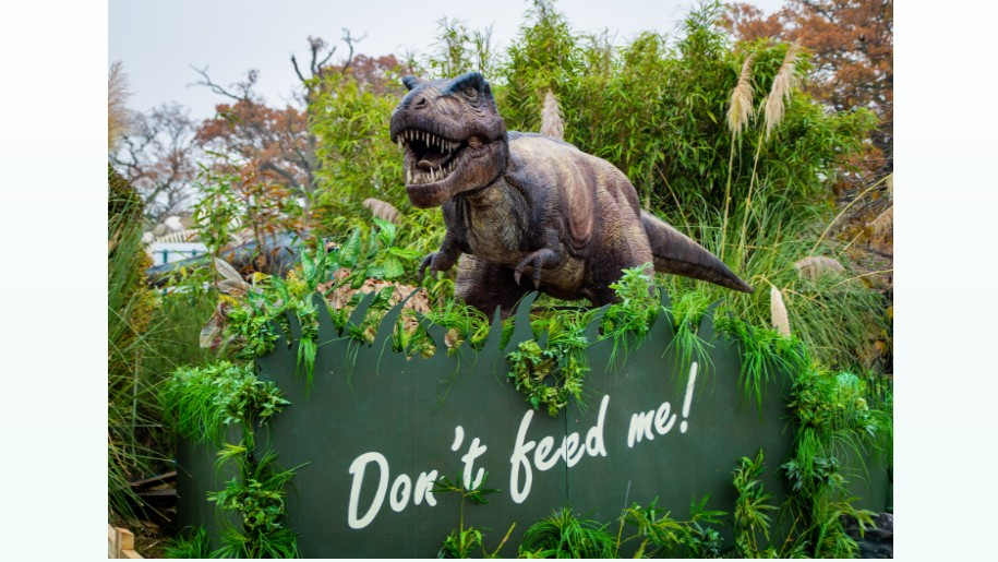 t-rex beside 'Don't feed me!' sign