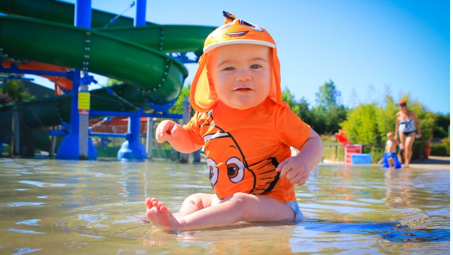 baby in shallow water paddle pool