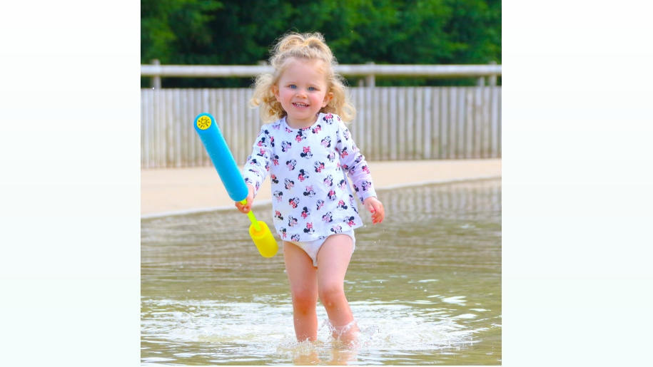little girl paddling in water park