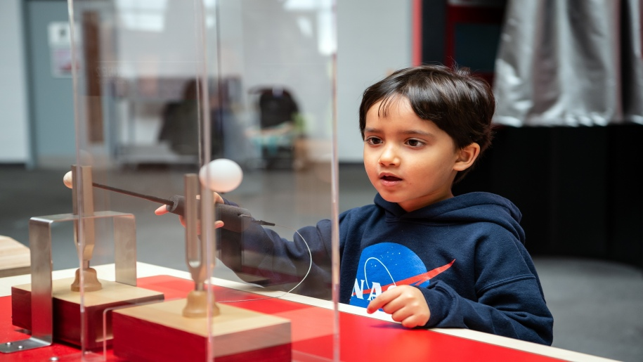 boy looking at floating ball at Winchester Science Centre