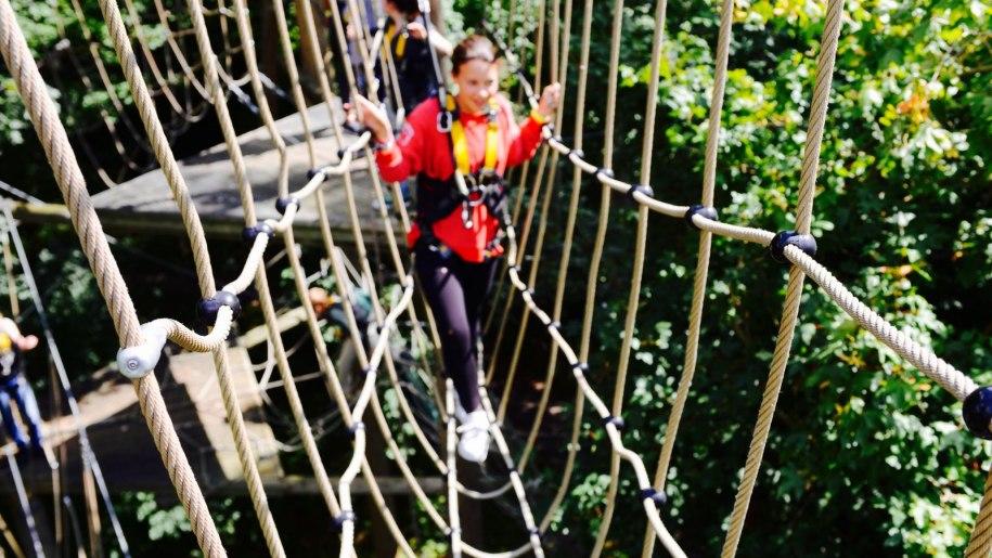 girl crossing high wire bridge at Wildwood