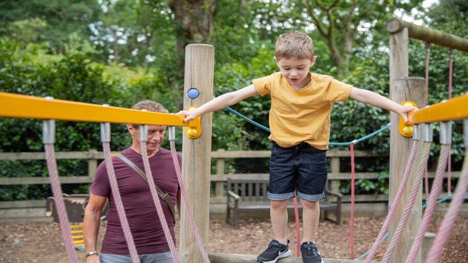 boy climbing on frame Exbury Gardens Hampshire