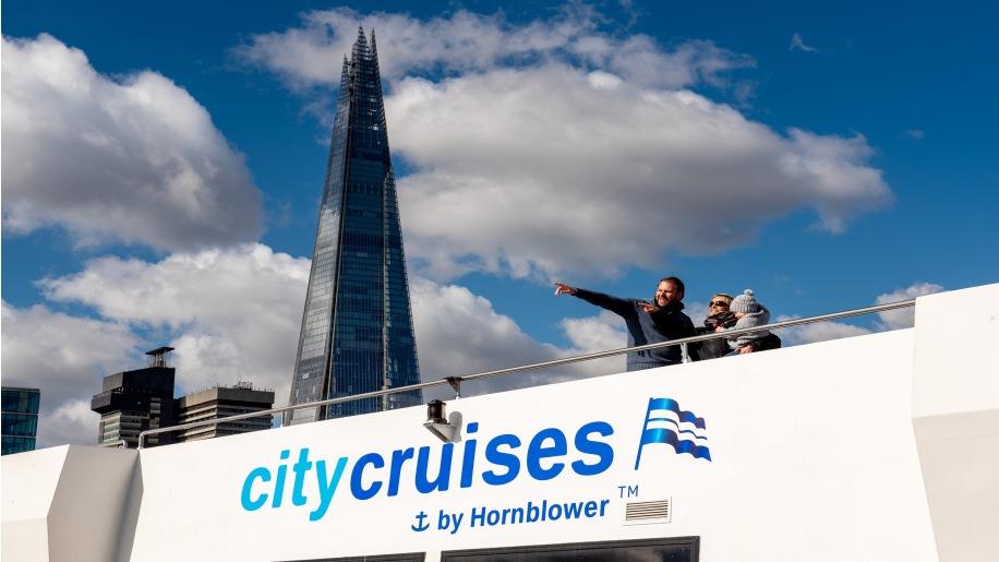family on cruise boat City Cruises