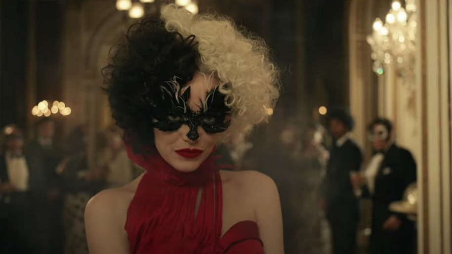 Emma Stone in mask with two tone hair as Cruella