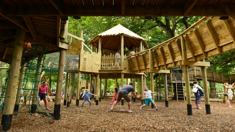 Holkham children playing in wooden play area 915 x 515