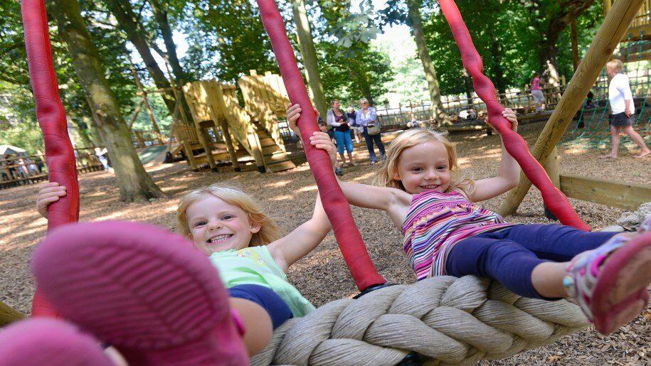 Holkham girls on swings 915x515