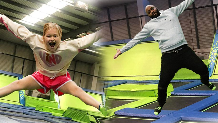 girl and man on trampoline