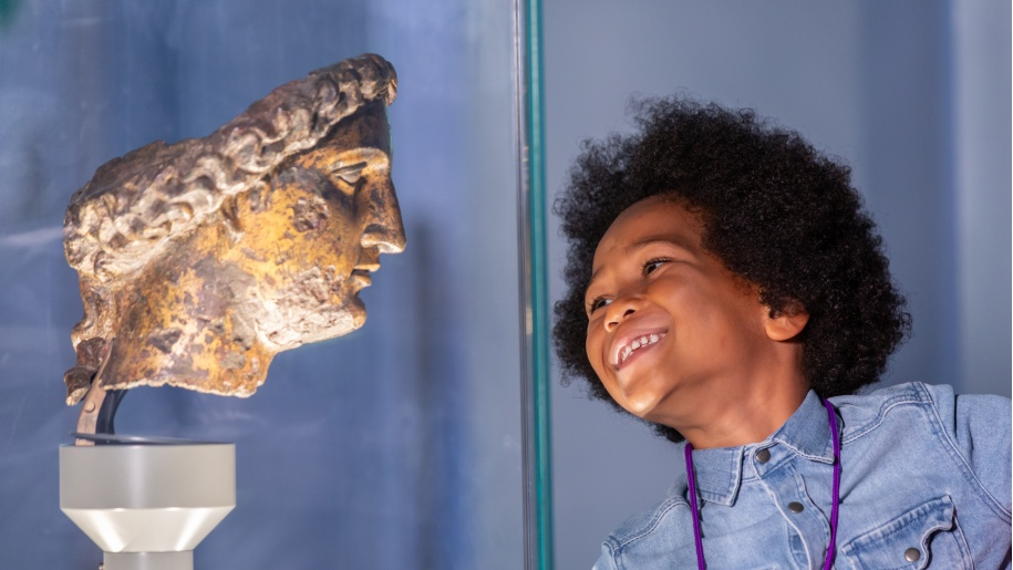 girl looking at ancient Roman statue