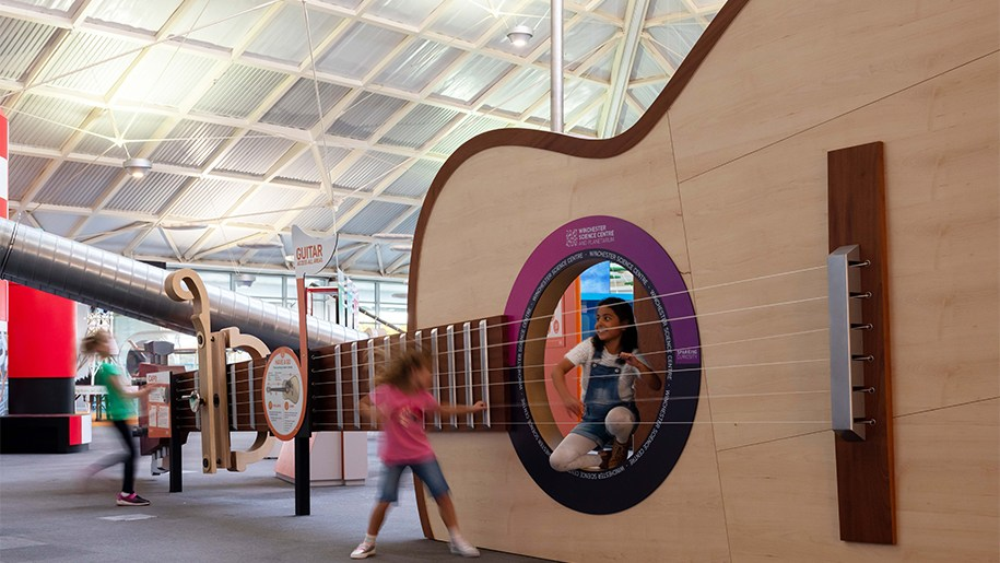 Winchester Science Centre girl with large guitar 915x515