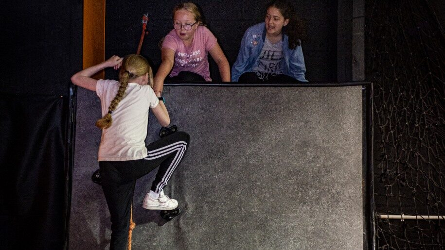 Girls on climbing wall at Egni Children's Activity Centre