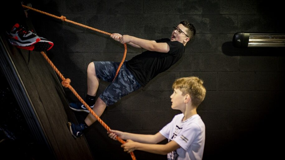 Boys climbing with ropes at Egni Children's Activity Centre