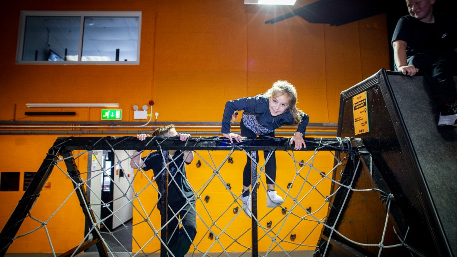 Girl on climbing net at Egni Children's Activity Centre