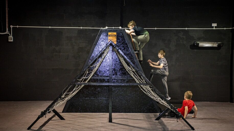 Three boys climbing an obstacle at Egni Children's Activity Centre