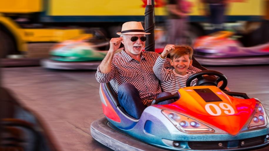 boy and dad in dodgem car at Gambado