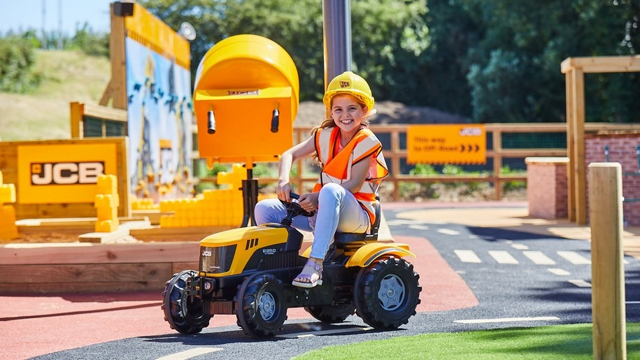 Girl on toy JCB at Adventure Land