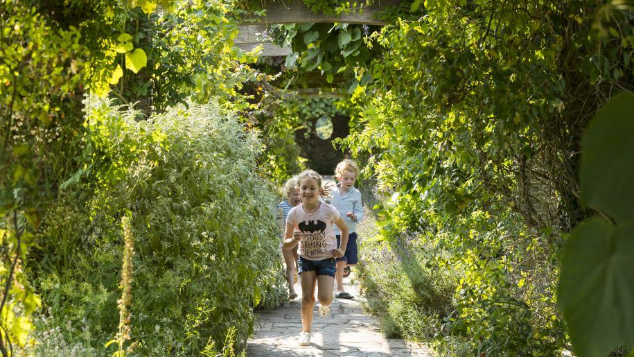 Children running along a path at Hestercombe Gardens