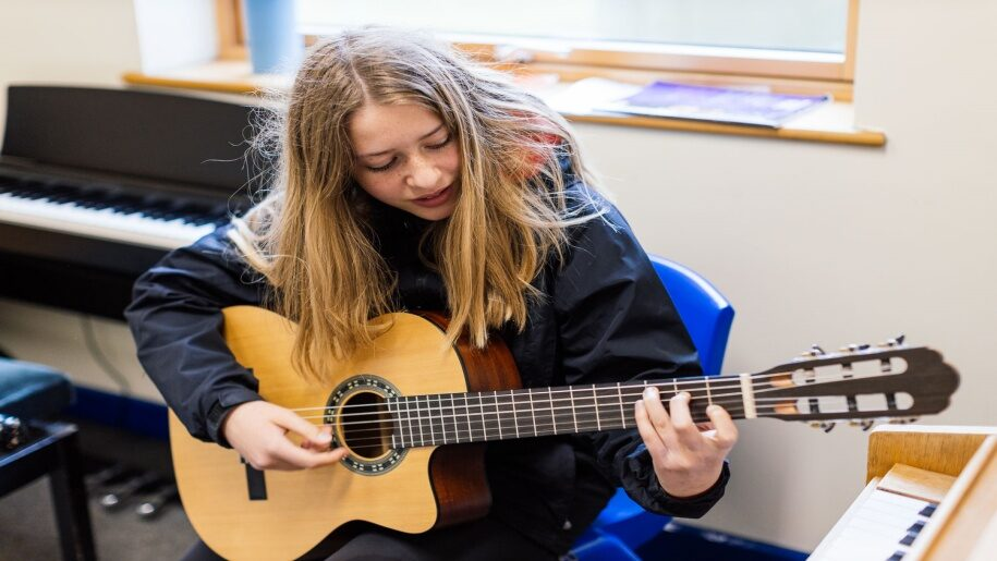Norfolk Centre for Young Musicians Open Day - Girl playing the guitar