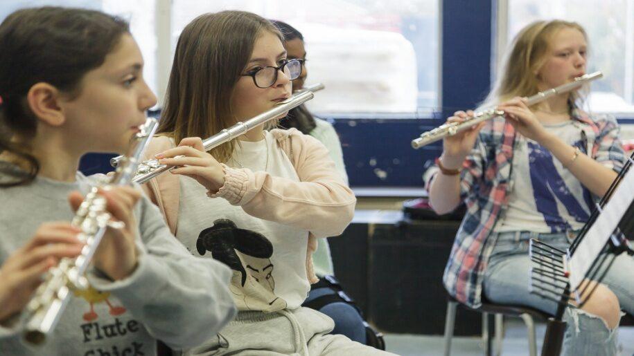 Saffron Centre for Young Musicians - Saffron Walden = Three older girls playing the flute