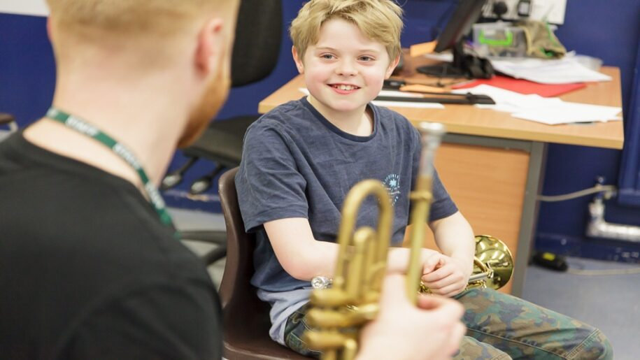 Saffron Centre for Young Musicians - Saffron Walden - Young boy with horn listening to his mentor