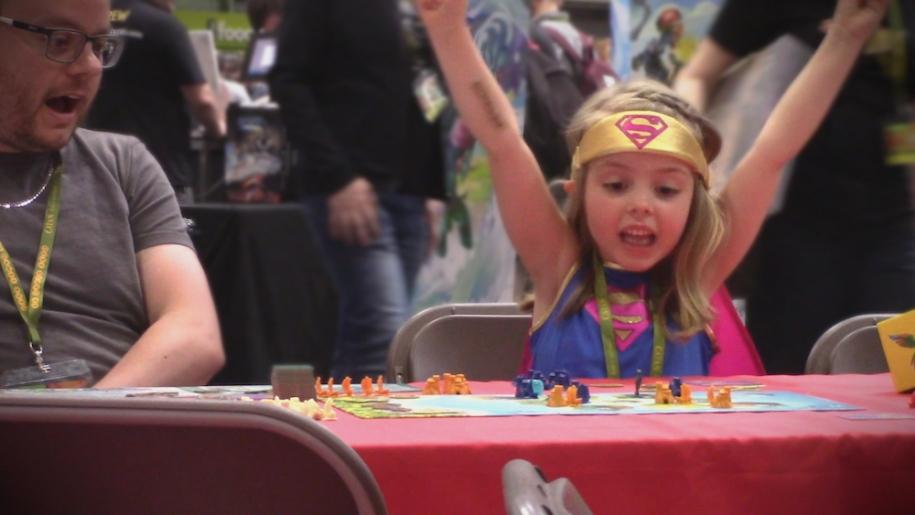 girl wining board game UK Games Expo