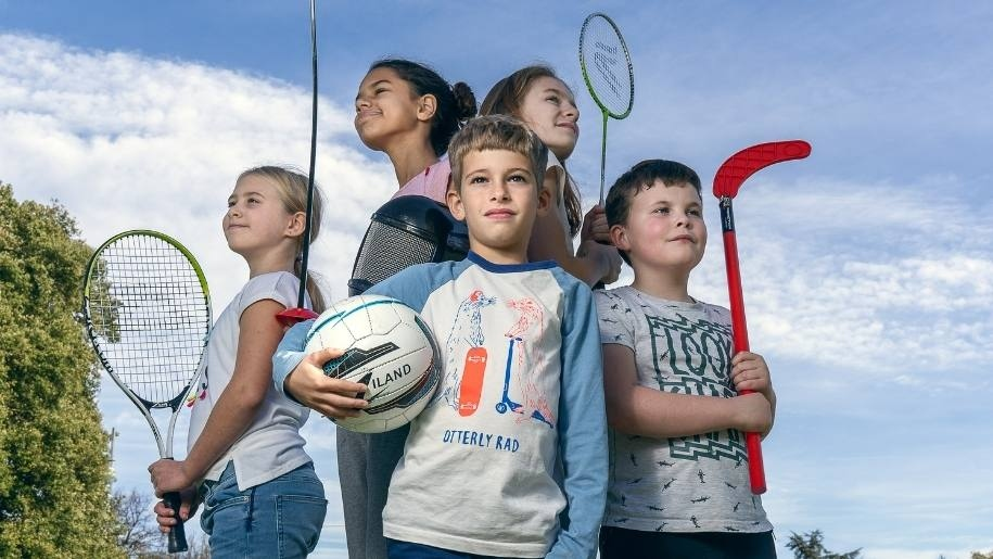 kids standing with sports equipment Ultimate Activity Camps
