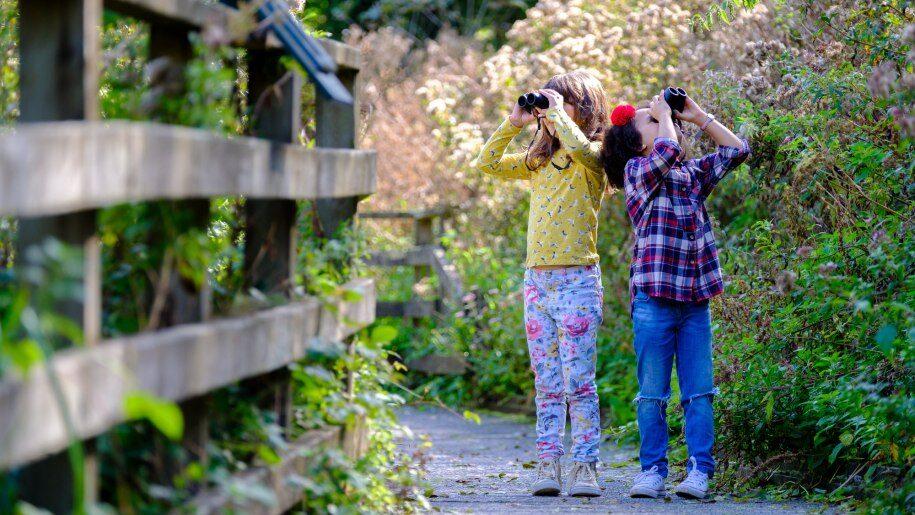 Children with binoculars at WWT Arundel Wetland Centre