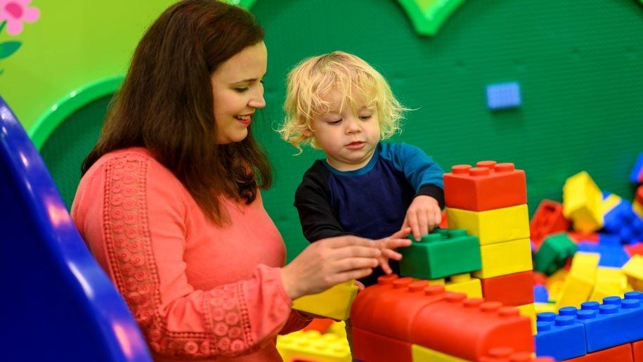 mum and boy with play bricks Legoland Discovery centre