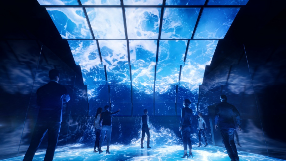 Exhibition London - The Blue Paradox visitors standing underneath the ocean.