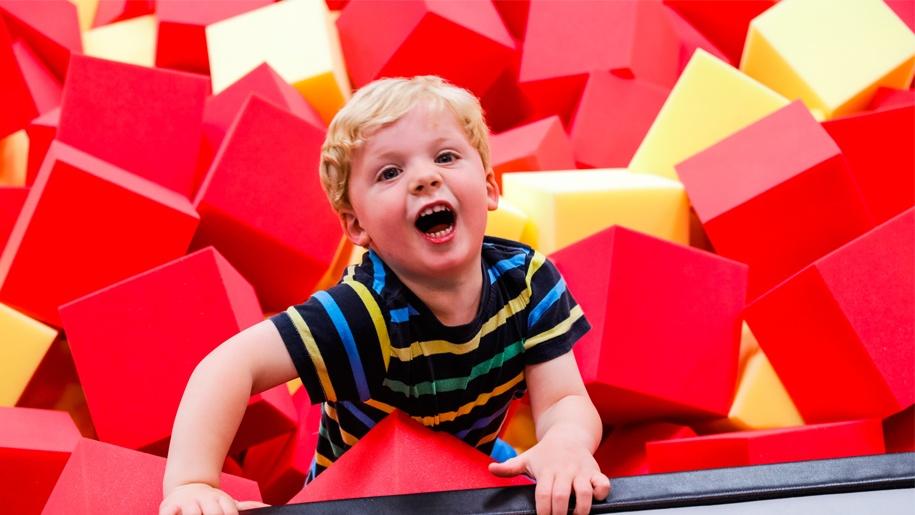 little boy playing in foam RedKangaroo