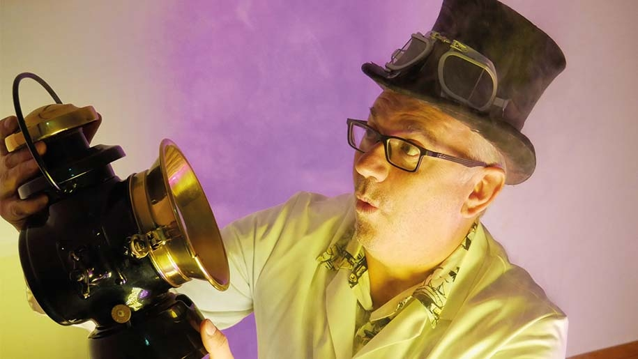 Mad scientist looking at an historic headlamp