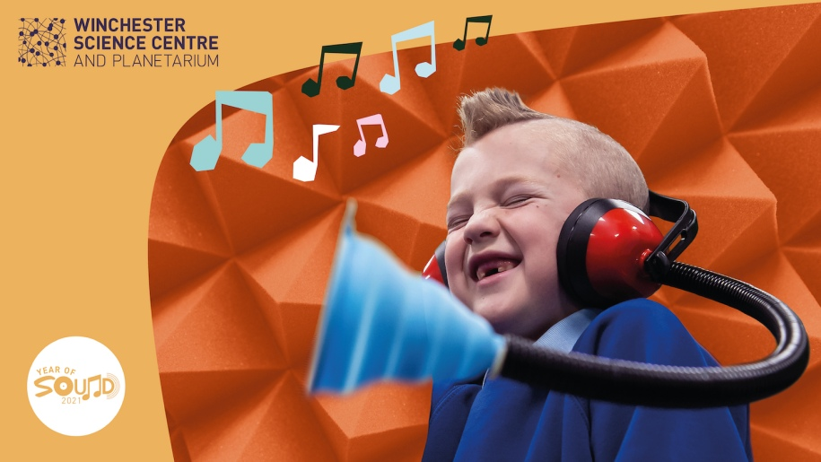 Winchester Science Centre - Young boy listen to music with headphones on