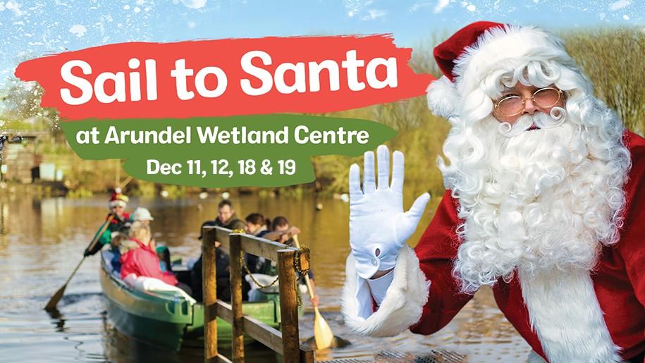 WWT Arundel - Sail to Santa 2021 Santa waving at quay as boat departs