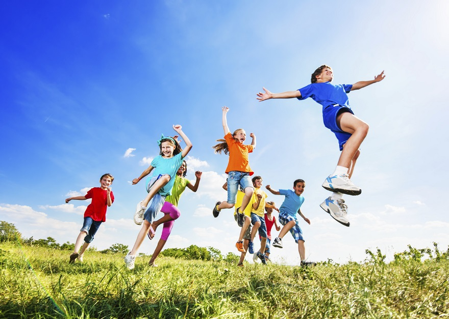 Kids jumping in field