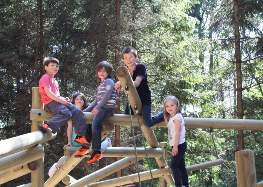 kids on wooden climbing frame