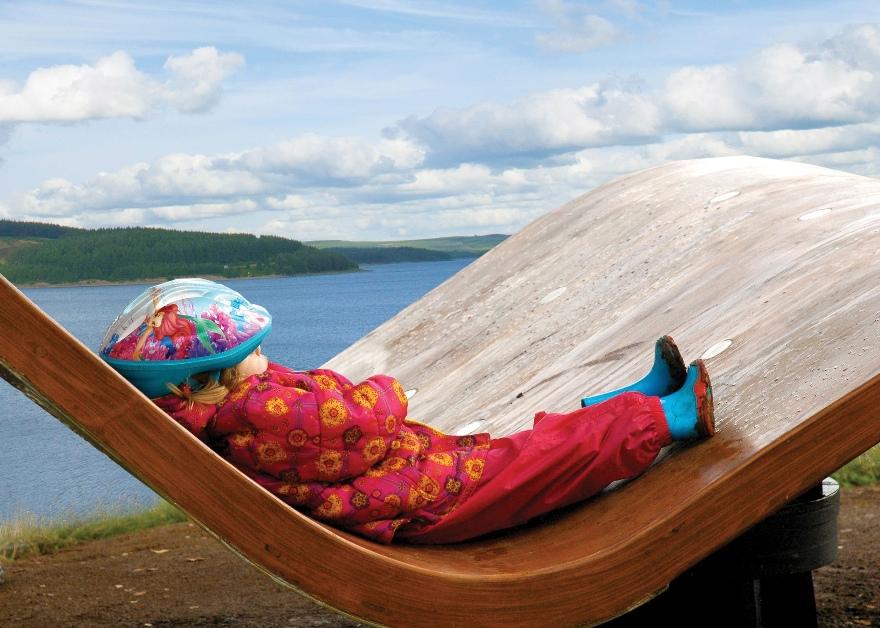 Kielder Water Forest Park child on bench