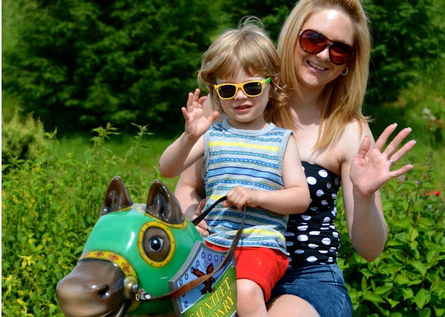 mother and child on carousel horse